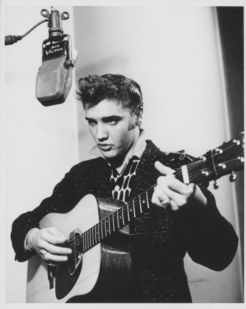 Elvis recording for Sun Records